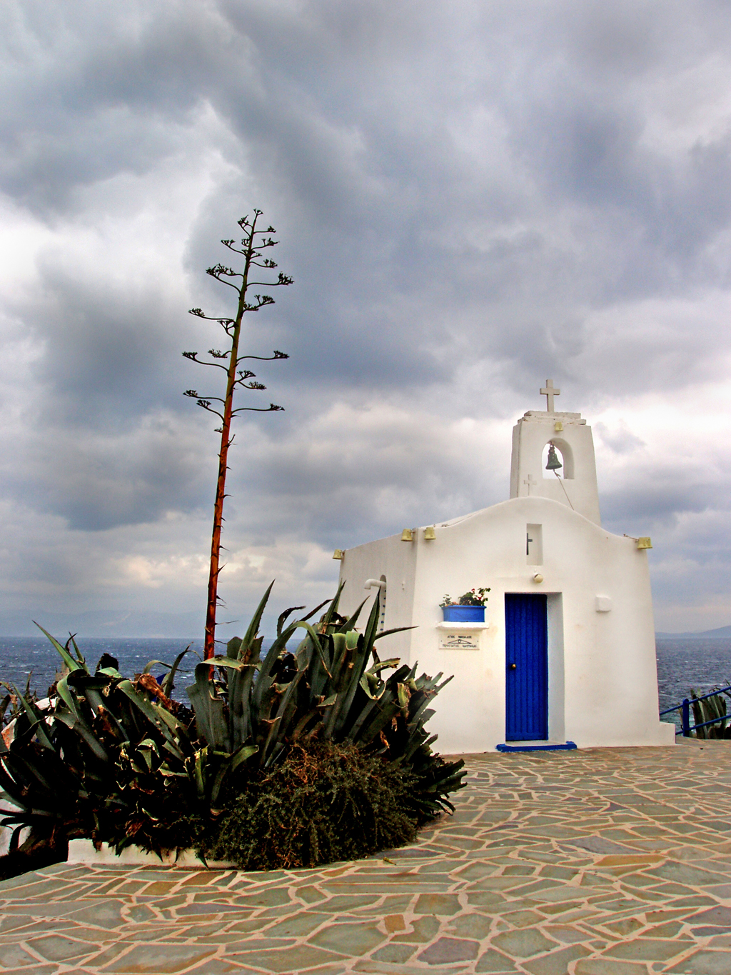 dreamstime_3167257_St_Nicolaos (Agios Nikolaos) Greek Orthodox church as storm clouds are forming above Rafina, Greece